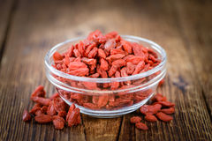 Goji Berries dried on vintage wooden background Royalty Free Stock Photography