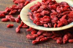 Goji berries. Dried goji berries on wooden background Stock Images