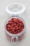 Goji berries in a glass jar Royalty Free Stock Image