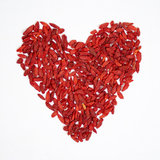 Goji berries in heart shape. Tibetan Goji Berries on white background Stock Photo