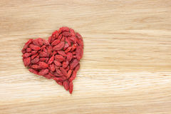 Goji berries in heart shape Stock Photo