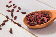 Goji Berries In A Wooden Spoon On A White Background. Stock Photo