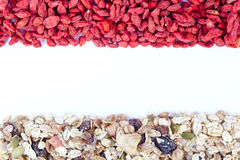 Goji berries and muesli Stock Photos