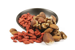 Goji Berries and Nuts Spilling from a Bowl Royalty Free Stock Image