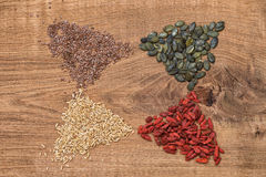 Goji berries, oats, linseed, pumpkinseed on wooden background Stock Photos