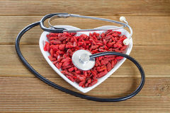 Goji berries in the shape of a heart Royalty Free Stock Photos