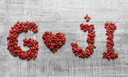 Goji berries in shape of heart Royalty Free Stock Photography