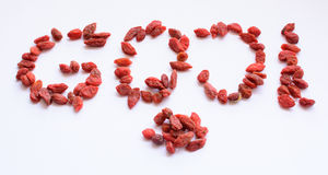 Goji Berries shaped into word 'goji' isolated on white Royalty Free Stock Photo