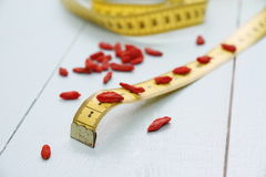 Goji berries and tape measure as concept of health Stock Photography