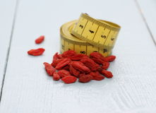 Goji berries and tape measure, concept of health Royalty Free Stock Photo