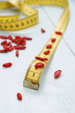 Goji berries and tape measure, concept of health Stock Images
