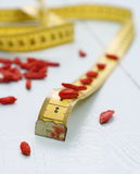 Goji berries and tape measure, concept of health, soft focus Royalty Free Stock Image