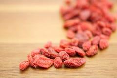 Goji berries. On wooden background Stock Photos