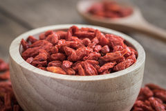 Goji berries in wooden bowl Stock Photos