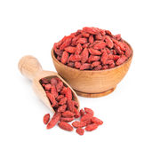 Goji berries in a wooden bowl isolated on white Royalty Free Stock Image
