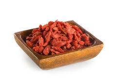 Goji berries in wooden bowl Royalty Free Stock Image