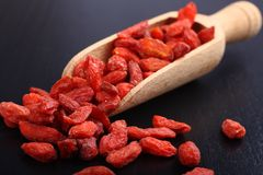Goji berries in wooden scoop, one of the superfoods Royalty Free Stock Photos