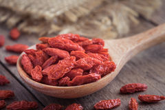 Goji berries on wooden spoon Stock Photo