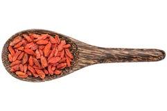 Goji berries on wooden spoon Royalty Free Stock Photos