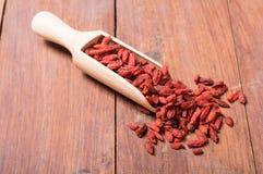 Goji berries in wooden spoon Stock Photo