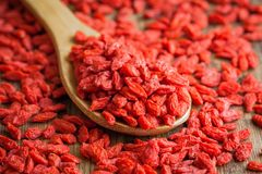 Goji berries in a wooden spoon Royalty Free Stock Photo