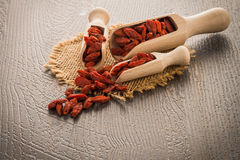 Goji berries on a wooden spoons Stock Images
