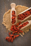Goji berries on a wooden spoons Stock Photo