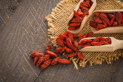 Goji berries on a wooden spoons Royalty Free Stock Image