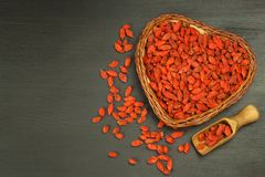 Goji berries on the wooden table. Traditional Chinese superfood. Healthy diet rich in minerals and vitamins. wolfberry. Lycium chi. Nense Stock Photo