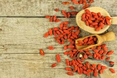 Goji berries on the wooden table. Traditional Chinese superfood. Healthy diet rich in minerals and vitamins. wolfberry. Lycium chi. Nense Stock Photography