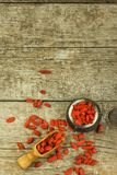 Goji berries on the wooden table. Traditional Chinese superfood. Healthy diet rich in minerals and vitamins. wolfberry. Lycium chi. Nense Royalty Free Stock Photo