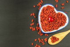 Goji berries on the wooden table. Traditional Chinese superfood. Healthy diet rich in minerals and vitamins. wolfberry. Lycium chi. Nense Stock Image