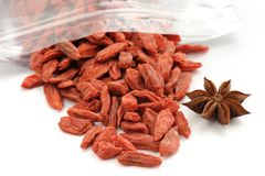 Goji berries in zip lock bag with star anise isolated Royalty Free Stock Images