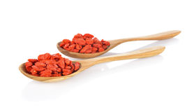 Goji berry or Chinese wolfberry in wooden spoon on white Stock Image