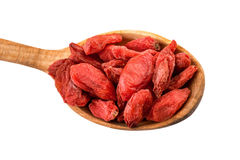 Goji berry. Dried goji berries on a wooden spoon isolated on white with clipping path Royalty Free Stock Images