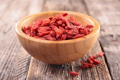 Goji berry. On wood background Stock Photography