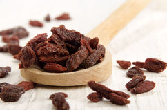 Goji berry on a wooden spoon Stock Image