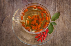 Goji fresh antioxidant tea in glass cup Royalty Free Stock Image