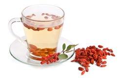 Goji fresh antioxidant tea. On white background Royalty Free Stock Photo