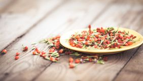 Goji fruits on wooden background Royalty Free Stock Image