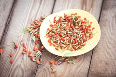 Goji fruits on wooden background Royalty Free Stock Photo