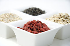 Goji, green tea, oat bran and oat flakes Royalty Free Stock Photo