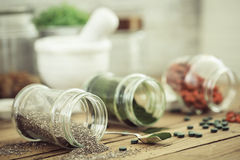 Goji, spirulina and  chia seeds (superfood). On wooden tabe Royalty Free Stock Photos