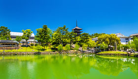 Goju-no-to five-storied pagoda above Sarusawa-ike Pond in Nara. Japan Royalty Free Stock Photo