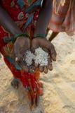 GOKARNA,INDIA - Feb 27: Salt plantation near Gokarna, India, han Royalty Free Stock Image