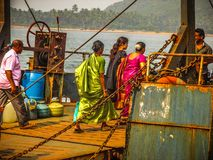 Colors of India. Gokarna Karnataka India December 13, 2017 View of unknowns people traveling in the ferry to Karwar in southern India royalty free stock photos