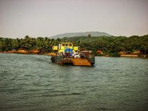 Colors of India. Gokarna Karnataka India December 13, 2017 View of unknowns people traveling in the ferry to Karwar in southern India royalty free stock photo