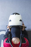 Gokart pilot puts the helmet on Stock Photo