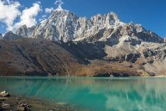 Gokyo lake and Machermo mountain peak, Everest region Royalty Free Stock Images