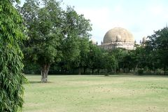Gol Gumbaz behind Garden. View of Gol Gumbaz-second biggest dome in the world- in Bijapur, Karnataka, India, Asia Royalty Free Stock Photos